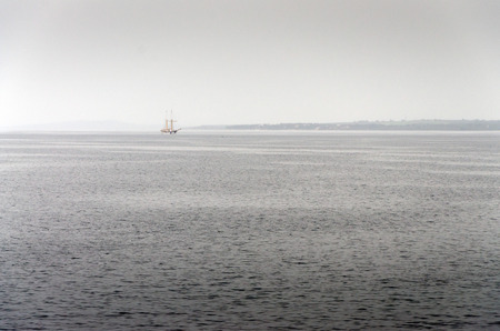 spinnaker: Sailboat on a foggy day in the Bay of Zadar, Croatia