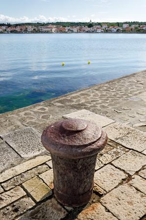 bollard: Bollard in harbor Petrčane:  a 900 years-old beautiful small fishermans village, 10 km northwest of Zadar.