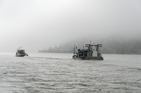 shipper: Cargo ships in the river Rhine on a foggy day Stock Photo