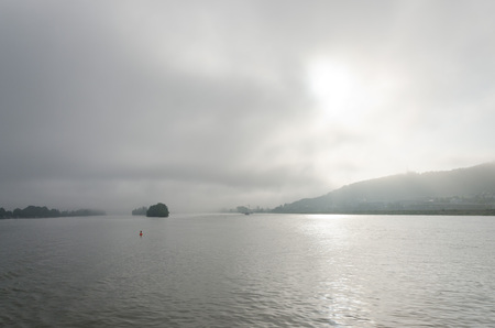 rudesheim: The Rhine River on its way through the town of Rudesheim, Germany, on a foggy morning