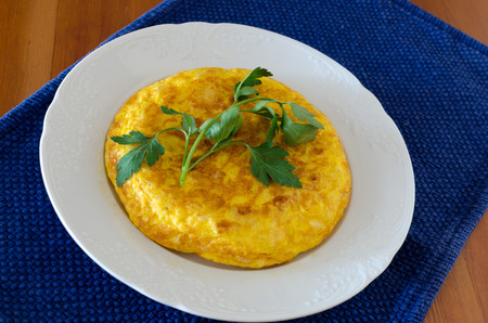 meat alternatives: Spanish typical food; an omelette made with fried potatoes and (sometimes), onion . She is adorned with parsley leaves