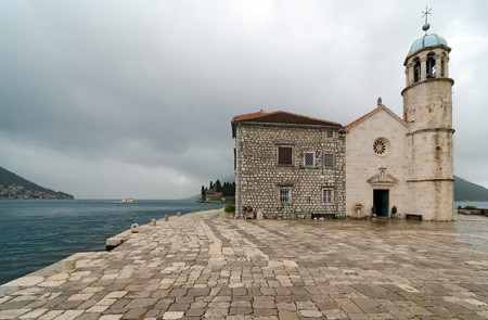 bulwark: Our Lady of the Rocks is one of the two islets off the coast of Perast in Bay of Kotor, Montenegro. It is an artificial island created by bulwark of rocks and by sinking old and seized ships loaded with rocks.