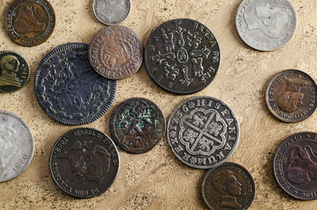 copper coin: Collection of old Spanish coins on a background old textured background