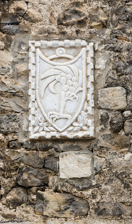 city coat of arms: Coat of Arms on a stone wall in the Croatian city of Sibenik