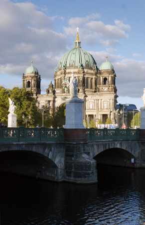 spree: the Cathedral in Berlin (Germany) with bridge over the river Spree and dramatic sky