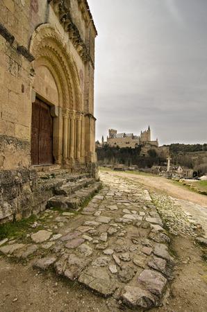 relates: View alcazar of Segovia from the Church of Vera Cruz Stock Photo