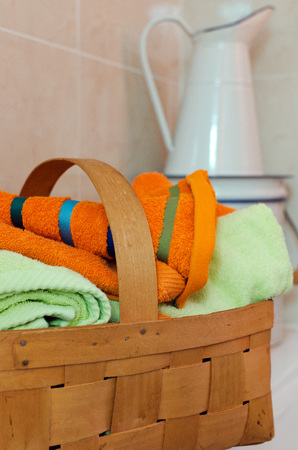 ewer: Basket for towels and white ewer Stock Photo
