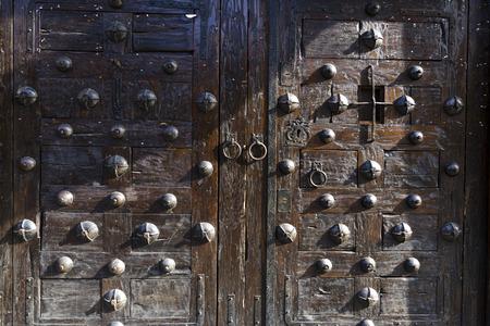 ironworks: Old wooden door with metal rivets Stock Photo