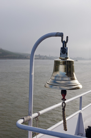 deportes nauticos: Bell on cruise ship with sailors knot on clapper. Rhine river, Germany
