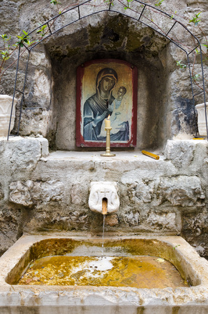 niche: Orthodox icon in a niche on a public fountain in the town of Kotor, Montenegro