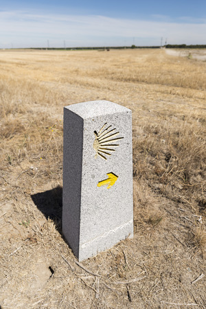 camino: Milestone with the Saint James Shell on it, showing that you are on the right path on the Way of Saint James (Camino de Santiago),