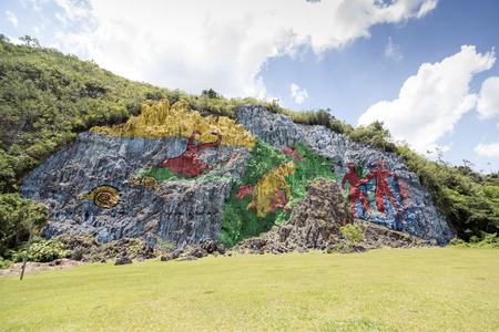 prehistory: The Mural of Prehistory, which is 120 meters high and 180 meter wide, was painted on the slope of the hill. It is a singular representation of the biological evolution of the Sierra de los Organos, in the western province of Pinar del Río. Vinales valley Editorial