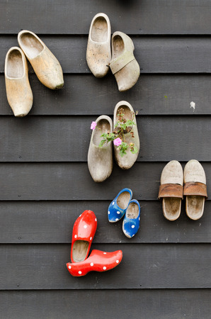 wooden shoes: traditional dutch wooden shoes hanging at a wall Stock Photo