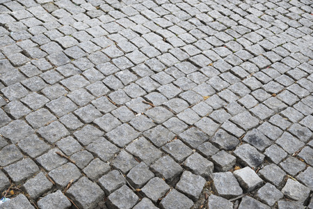 cobbled: Detail of a cobbled road. Porto, Portugal