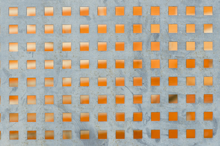 perforated: Closeup of a perforated metal plate