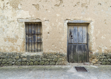 door casing: Facade of an old house in a village in Castile, Spain Stock Photo
