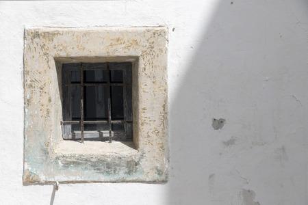 whitewashed: small window trellis in a whitewashed wall. Ibiza