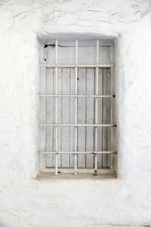 whitewashed: small window trellis in a whitewashed wall. Ibiza