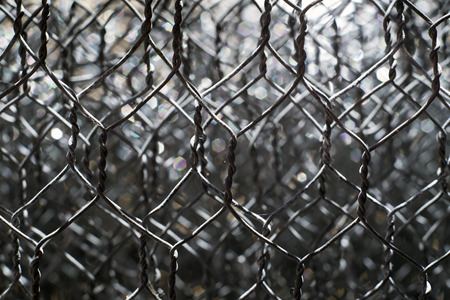 enclose: closeup of a roll of wire fence Stock Photo