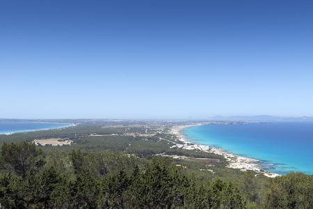 northern spain: Formentera island, Spain. View on northern rocky coastline. On the horizon is Es Vedra