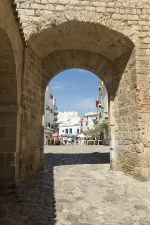 reading materials: Old town walls and gateway to the old town part of Ibiza Town, on the island of Ibiza.