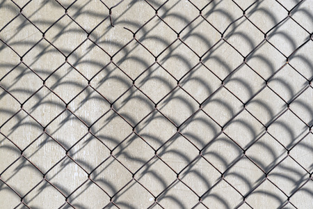 wire fence: wire fence and its shadow