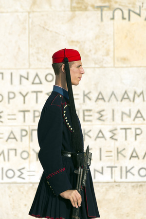 ATHENS, GREECE - OCTOBER 26, 2015: Evzone presidential guard at the monument of Unknown Soldier in front of the Greek Parliament Building at Syntagma Square