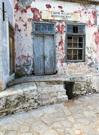 house donkey: HYDRA, GREECE - OCTOBER 25, 2015: A very old store at Hydra island in Greece