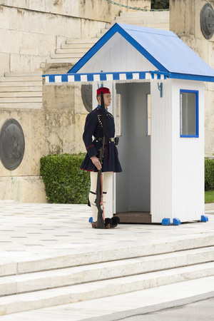 syntagma: ATHENS, GREECE - OCTOBER 24, 2015: Evzone presidential guard at the monument of Unknown Soldier in front of the Greek Parliament Building at Syntagma Square