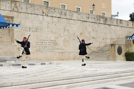 evzone: ATHENS, GREECE – OCTOBER 24, 2015: Evzone (presidential guard) at the monument of Unknown Soldier in front of the Greek Parliament Building at Syntagma Square