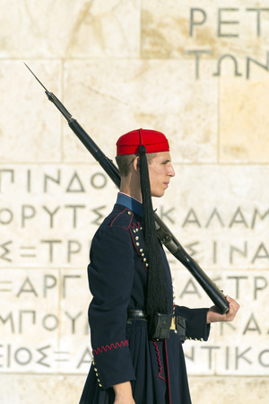 syntagma: ATHENS, GREECE – OCTOBER 26, 2015: Evzone (presidential guard) at the monument of Unknown Soldier in front of the Greek Parliament Building at Syntagma Square Editorial