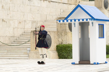 syntagma: ATHENS, GREECE – OCTOBER 24, 2015: Evzone (presidential guard) at the monument of Unknown Soldier in front of the Greek Parliament Building at Syntagma Square