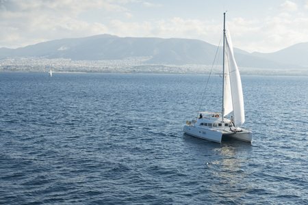 sailboat: sailboat sailing ship in the Aegean sea. In the background the city of Athens is