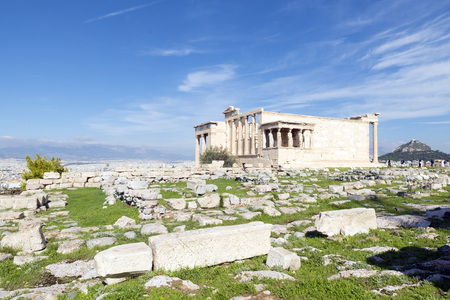 athena: The Erechtheion is an ancient Greek temple on the north side of the Acropolis of Athens in Greece which was dedicated to both Athena and Poseidon. Stock Photo