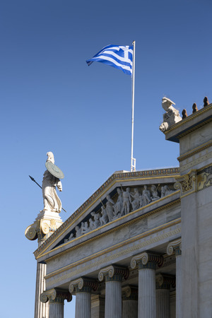 athena: Statue of Athena and the Greek flag on the facade of the Academy of Athens. Copy space Stock Photo