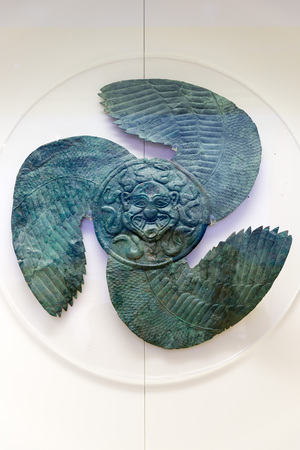 representations: OLYMPIA, GREECE - OCTOBER 29, 2015: Archaeological Museum of Olympia. Ancient weapons often carry carved or inscribed representations as do the metal ornaments on breastplates and shields.