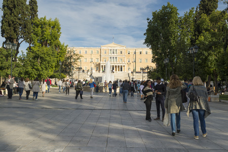 syntagma: ATHENS, GREECE - OCTOBER 26, 2015: People at Syntagma Square with fountain and Parliament building Editorial