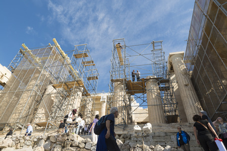 ensuring: ATHENS, GREECE - OCTOBER 26, 2015: Acropolis behind the crane. The Acropolis Restoration Project has been running since 1975, ensuring the best possible preservation and conservation of the Acropolis of Athens