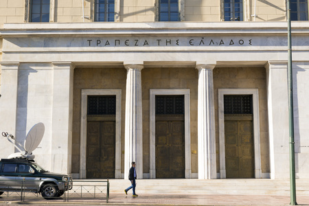 greek alphabet: ATHENS, GREECE - OCTOBER 27, 2015: A man goes to the Bank of Greece