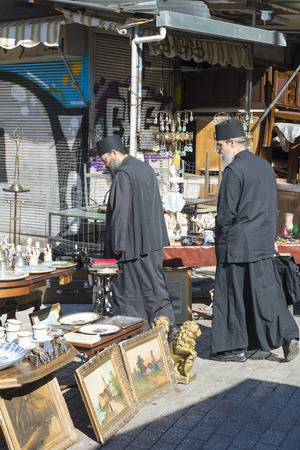 priests: ATHENS, GREECE - OCTOBER 27, 2015: Flea market at Avissinias Square. Two Orthodox priests to bargain hunting Editorial