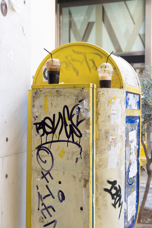 hellenic: ATHENS, GREECE - OCTOBER 27, 2015: Dirty and damaged telephone booths in Athens. OTE is the Hellenic Telecommunications Organization Editorial