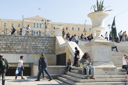 syntagma: ATHENS, GREECE - OCTOBER 27, 2015: A young man plays guitar among pedestrians at Syntagma Square