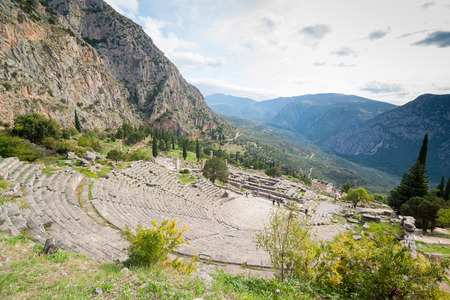 inscribed: The archaeological site of Delphi has been inscribed upon the the World Heritage List of UNESCO.View on  amphitheater with mountains