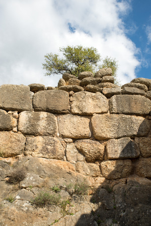 archaeological sites: Typical cyclopean masonry wall in the archaeological site of Mycenae Greece. The archaeological sites of Mycenae and Tiryns have been inscribed upon the World Heritage List of UNESCO Stock Photo