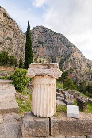 greek column: The archaeological site of Delphi has been inscribed upon the the World Heritage List of UNESCO. Detailed Greek column in foreground