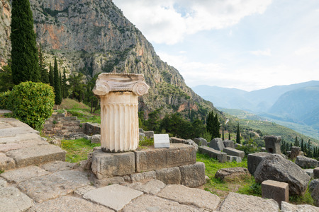 past civilization: The archaeological site of Delphi has been inscribed upon the the World Heritage List of UNESCO. Detailed Greek column in foreground