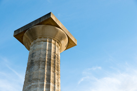 ionic: Ionic Greek column against a blue sky. Copy space