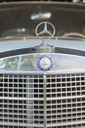 grille: ATHENS, GREECE - OCTOBER 29, 2015: The radiator grille for Mercedes-Benz oldtimer car parked in a street Editorial