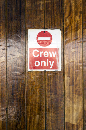 posted: A door with a Crew Only sign posted