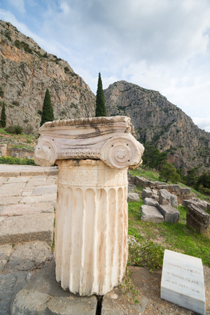 greek column: The archaeological site of Delphi has been inscribed  Detailed Greek column in foreground Stock Photo